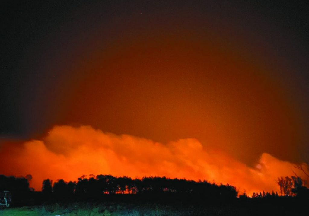 A WILDFIRE BURNED NEARLY 2,000 ACRESin McKinley and Cannon townships last week in rural Lancaster. The fire cast and ominous glow for residents in the area, as shown here. (Submitted photo)