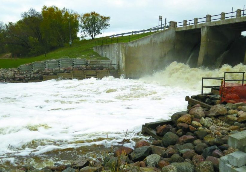THE LAKE BRONSON DAM, above right, is wide open as water continues to flow into the lake from the east. Rains over the weekend increased the lake level. With the extra water, a flood warning remains in effect downstream for Hallock. 			           (Enterprise photos by Anna Jauhola)