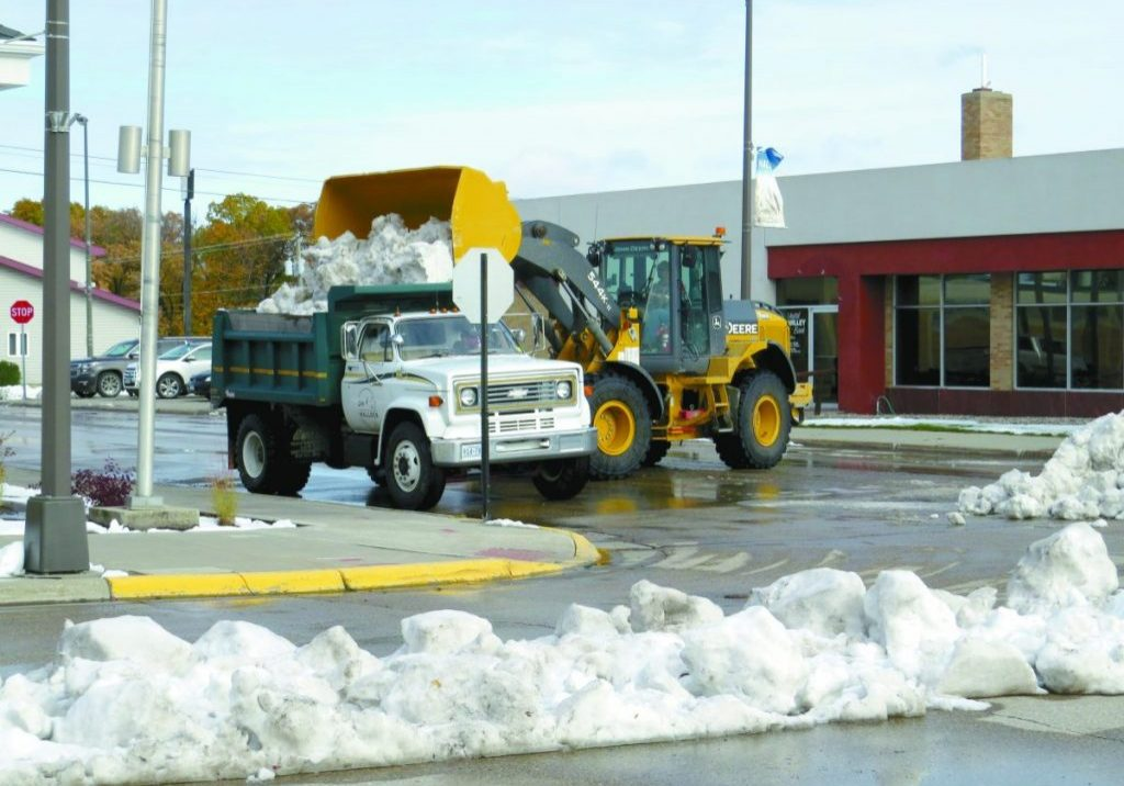 HALLOCK CITY CREWS were out Monday morning clearing the remaining piles of snow from city streets. The area got between 1 and 2 inches of snow over the weekend.  (Enterprise photo by Anna Jauhola)