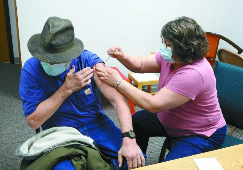 OWEN SWENSON received his second dose from Nurse GINGER LEDOUX. (Enterprise photos by Anna Jauhola)
